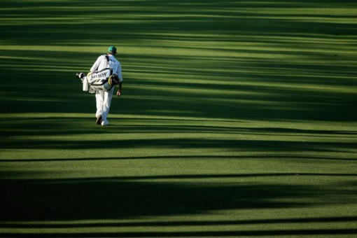 Steven Hale, caddie for Keegan Bradley, takes a seemingly lonely stroll down the fairway on the 18th hole Thursday. Photo: Andrew Redington/Getty Images