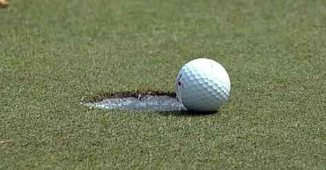 I cant imagine Graham DeLaet was very happy after seeing how close this putt came to sinking on the 10th hole Friday.  Photo: CBS Sports